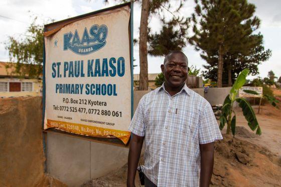 Dominic at KAASO School sign